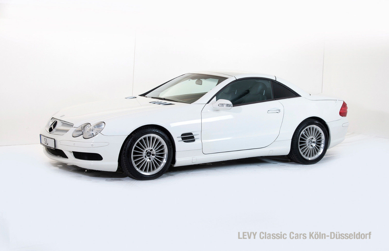 mercedes benz sl 500 mit neuer inspektion abc fahrwerk. Black Bedroom Furniture Sets. Home Design Ideas